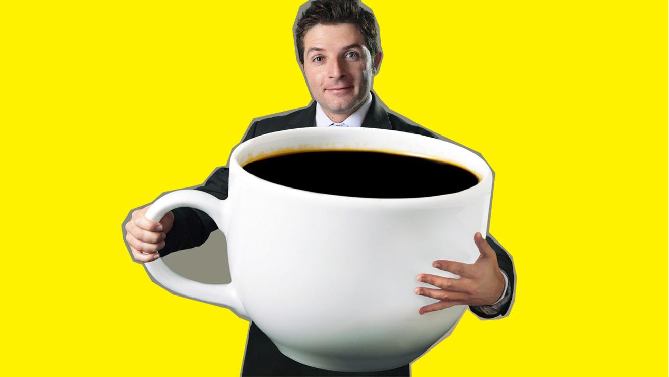 man with large cup of coffee