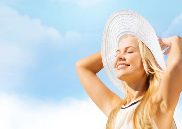 Woman smiling at sun